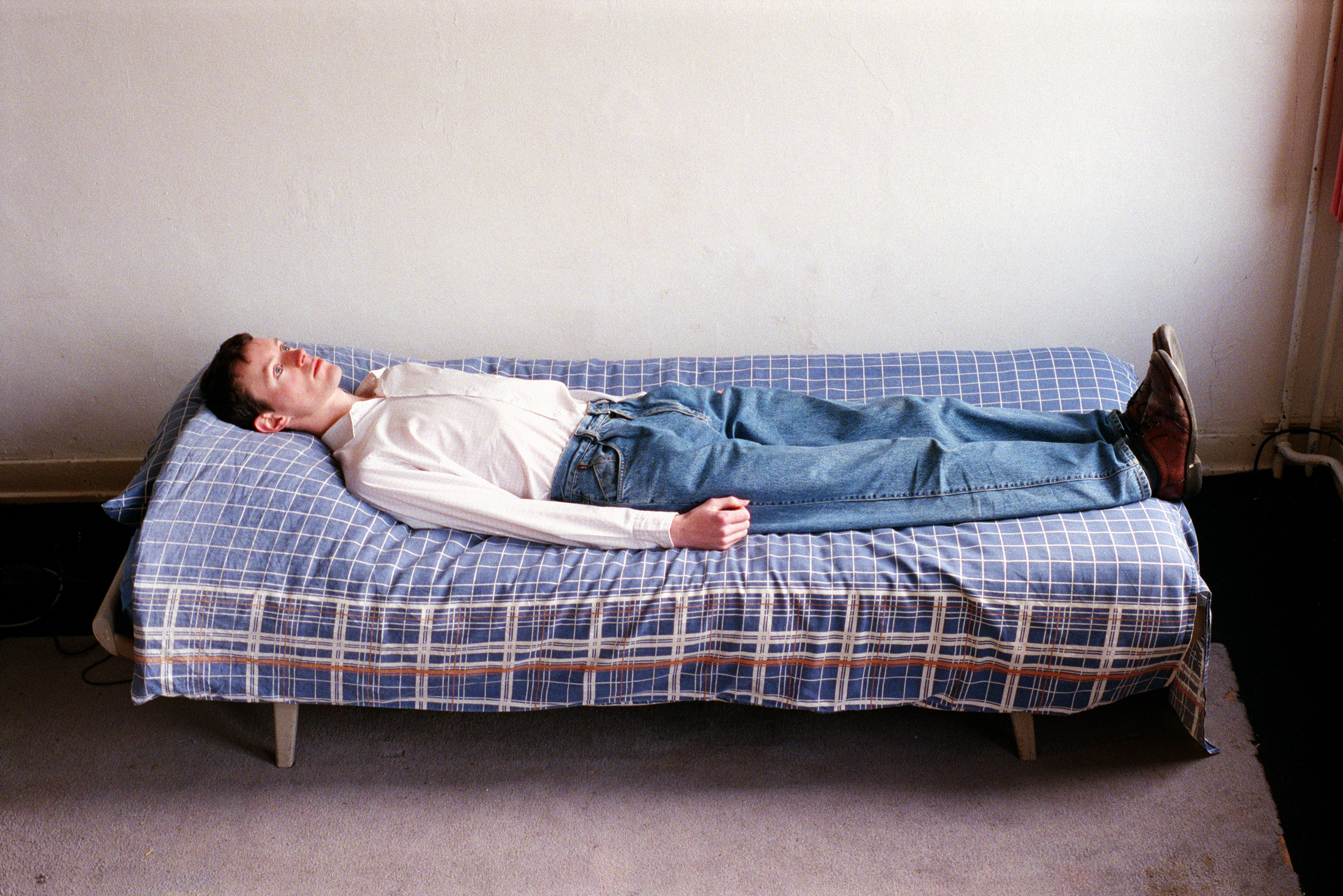 Self-portrait on Bed II, photograph by Wouter van Riessen